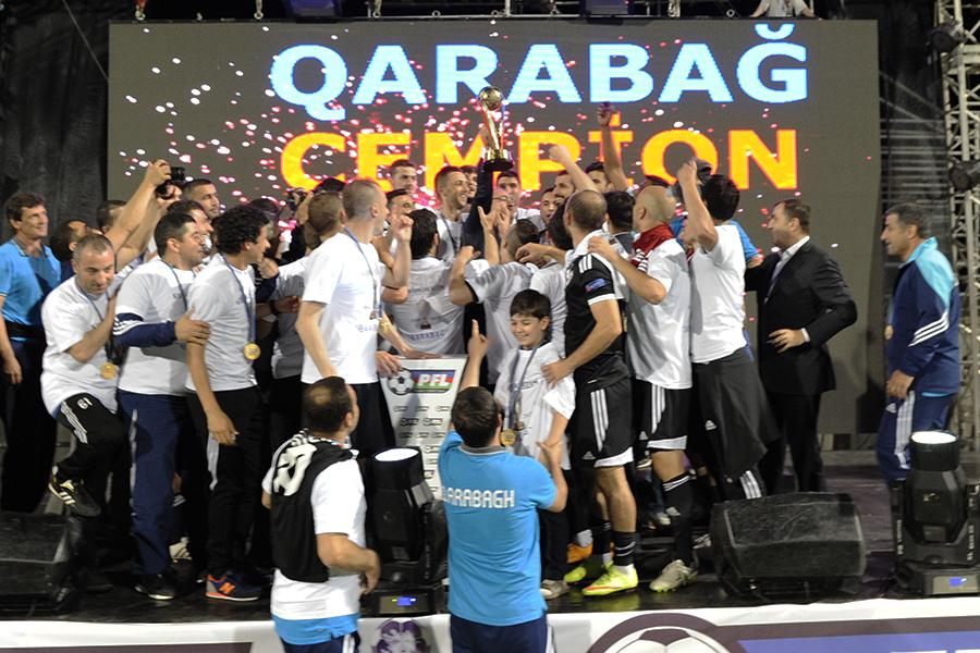 Muarem and teammates celebrate winning the cup trophy