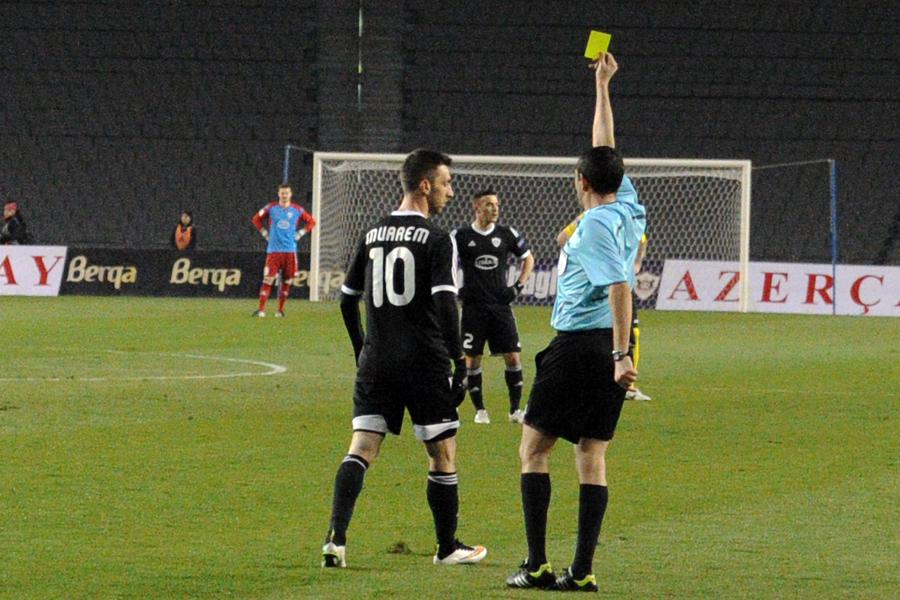 Muarem is shown a yellow card
